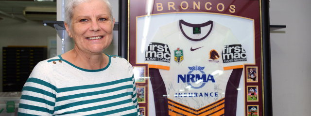 Merilyn May donates broncos jersey PAH
