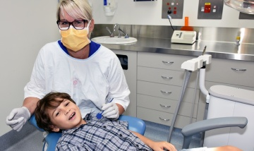 Dental therapist with child at QEII dental clinic