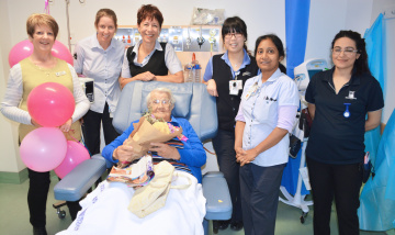 Day Therapy staff help Mona celebrate her 98th birthday