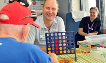 PA Hospitals Dementia Clinical Nurse Consultant, Fred Graham, practicing diversonal therapy with a patient