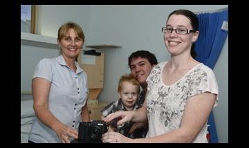 Family donating a camera to Logan Hospital