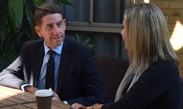 Minister Dick visits the Logan DABIT team