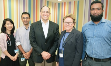 US Professor in gastroenterology visits with staff at Logan Hospital